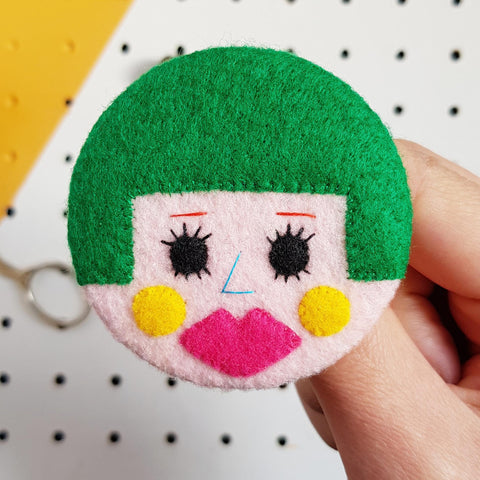 felt face badge with green bobbed hair