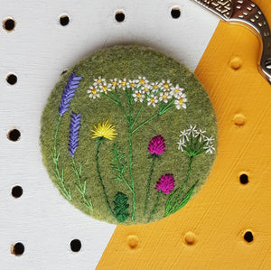 green wild flowers badge