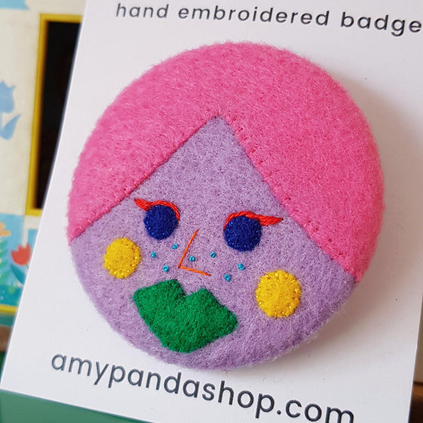 Lilac face badge
