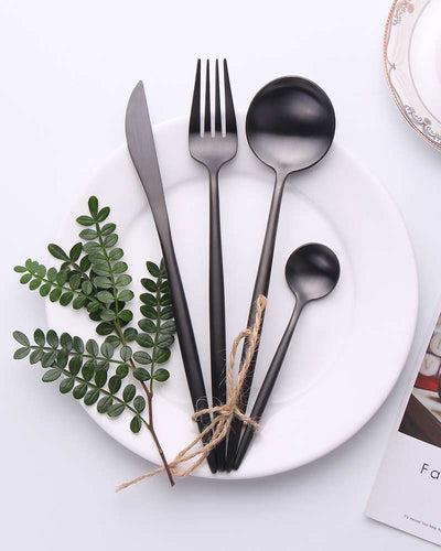Black cutlery on a white plate