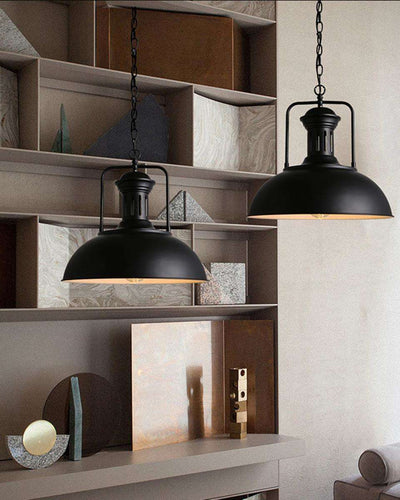 Two ceiling lamps in industrial black color hanging in a living room