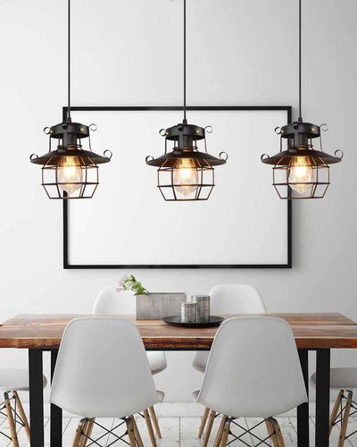 Three ceiling lamps with a cage shape hanging on top of a dining table in a white room