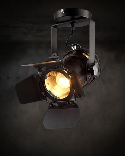 A ceiling lamp in a camera shape on black background