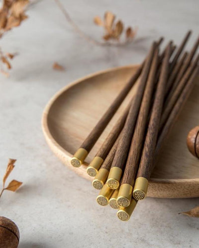 Chopsticks of real wood with a gold finish at the end