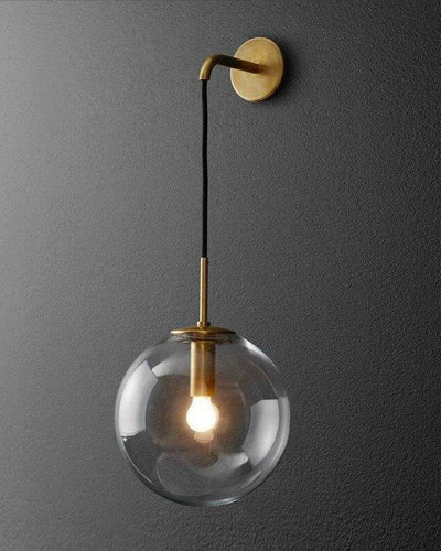 Nordic Wall lamp made of bronze and gold hanging on a gray wall