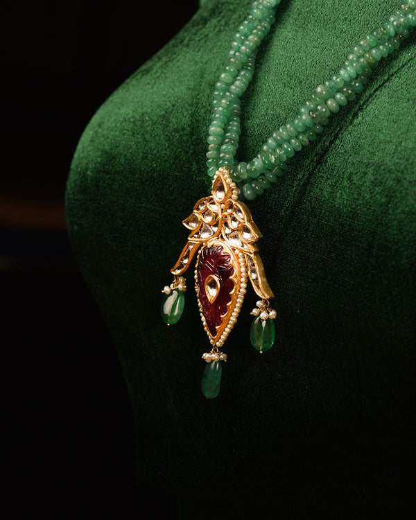 GOLD BIRD PENDANT WITH CARVED TOURMALINE