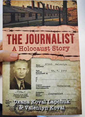 Oxana Lapchuk holding the paperback book of The Journalist a holocaust story