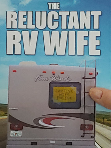 Author Gerri Almand holds papeback copy of The Reluctant RV Wife