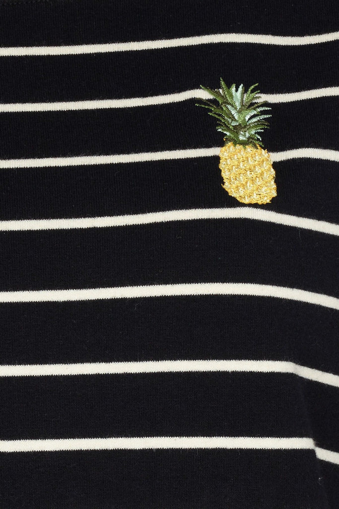 Black top with white stripes and pineapple design