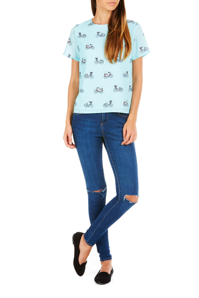 Aqua green top with bicycle print