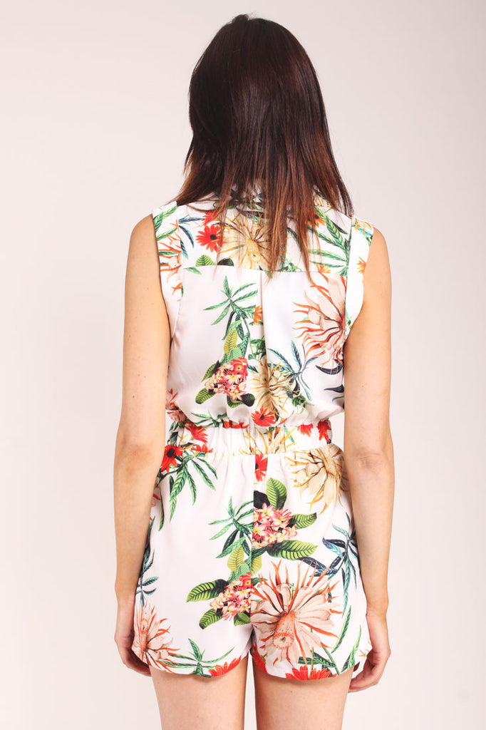 White playsuit with v-neck and palm floral print