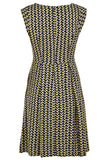 Louche retro-inspired yellow and navy printed dress