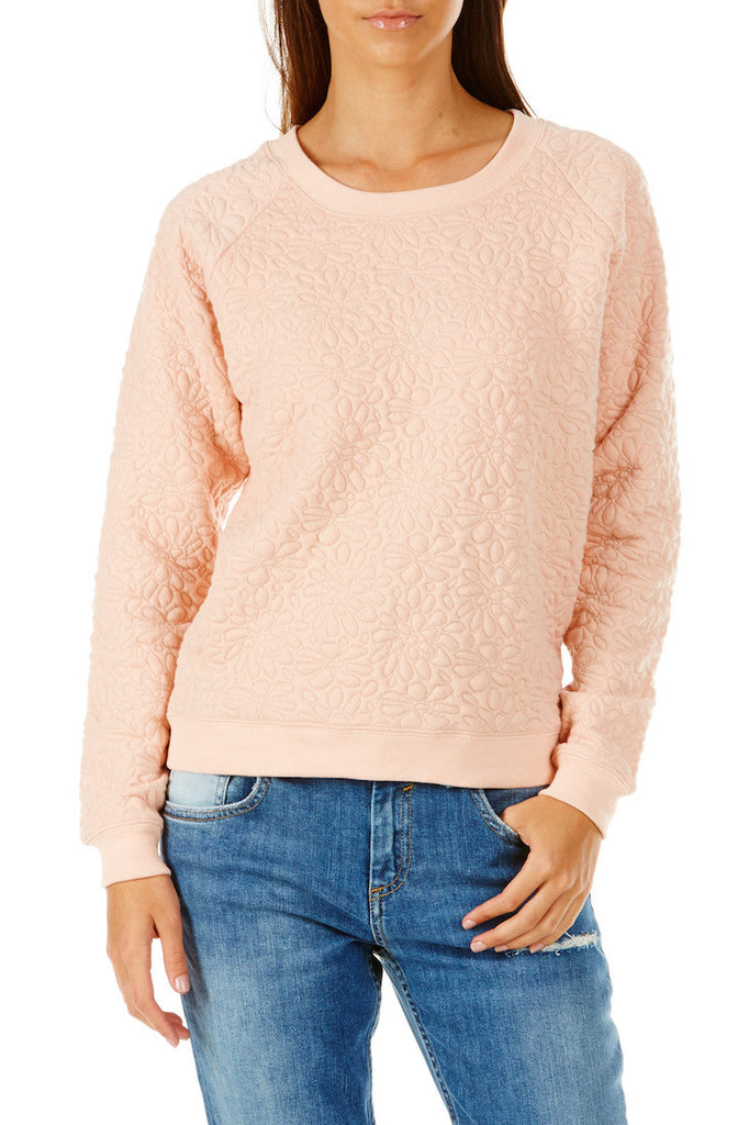 peach sweater with allover embossed floral pattern.