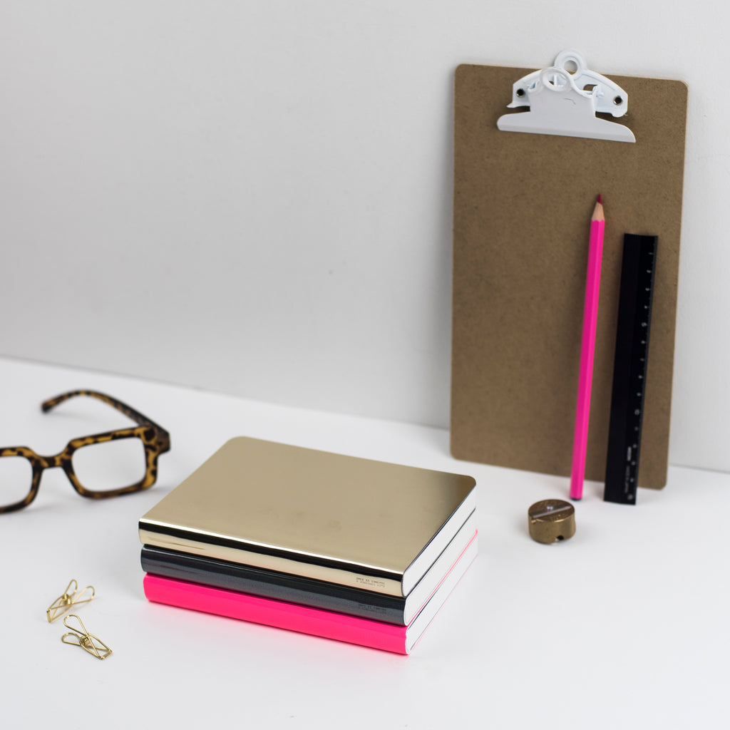 gold neon pink and holographic nuuna notebooks