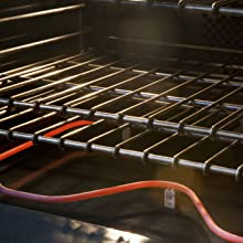 Heat stable insulation for furnace and oven controls