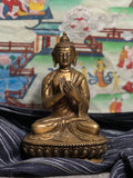 Bronze Buddha Dharmachakra mudra turning the wheel of dharma