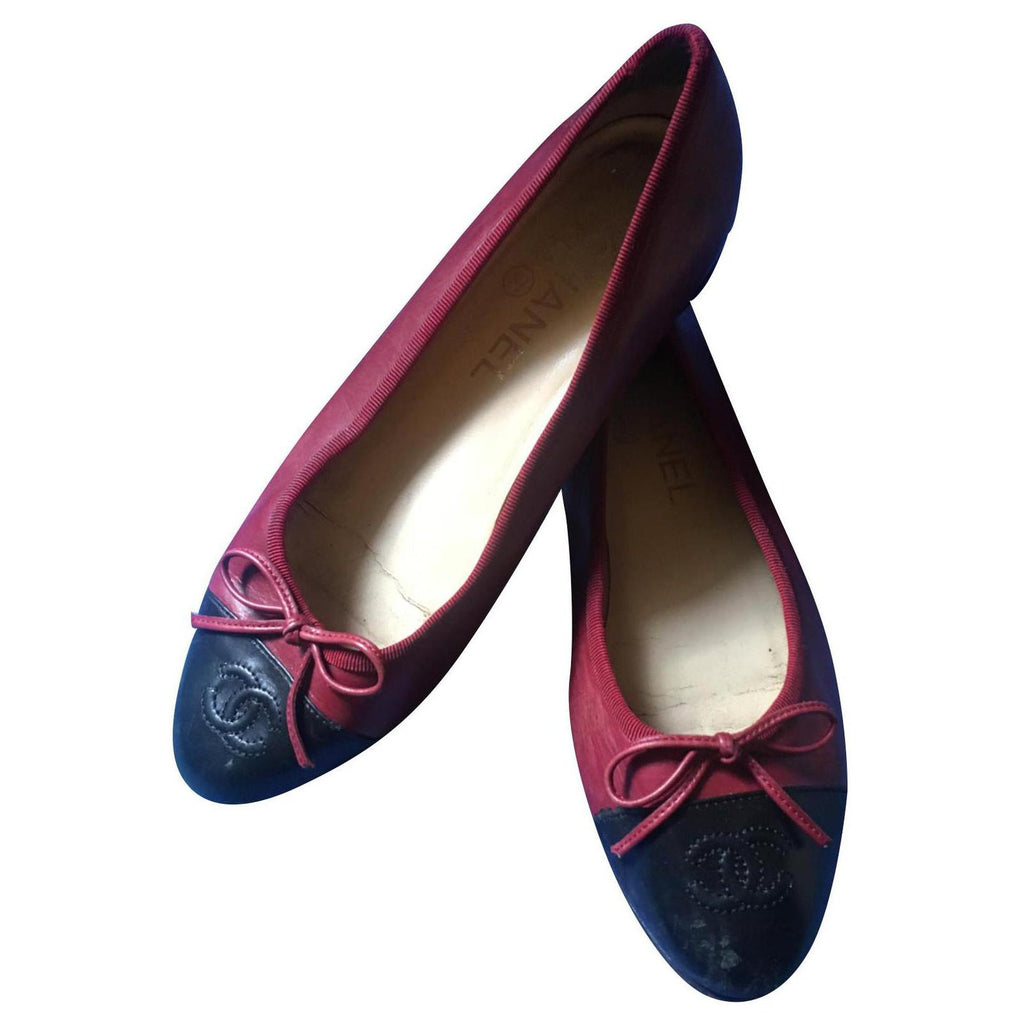 chanel ballet flats, burgundy and black leather, with CC logo and ribbon.