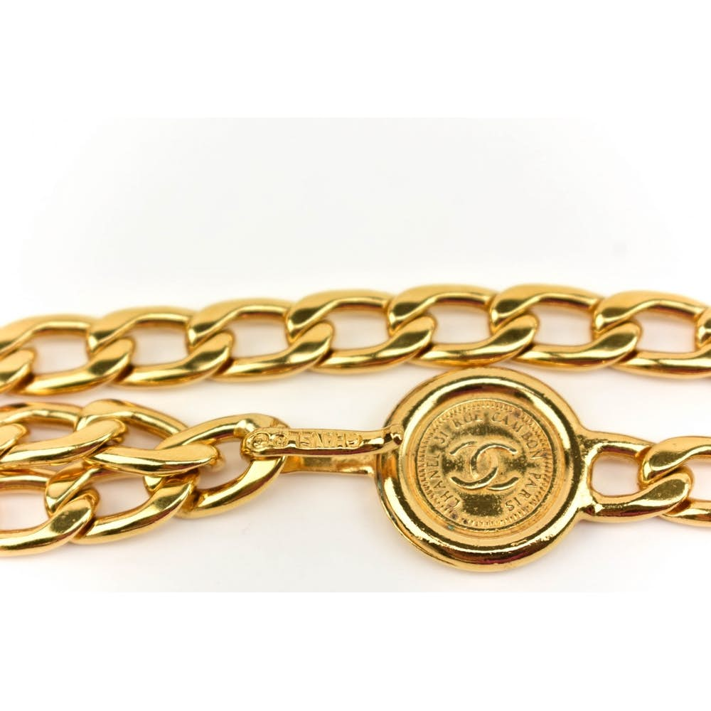 chanel chain belt in gold with CC logo and medallion.