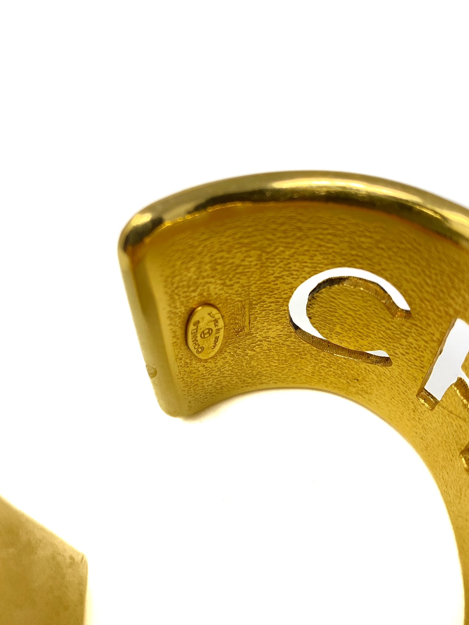 chanel gold bangle, quilted with logo cut-out.-bangle
