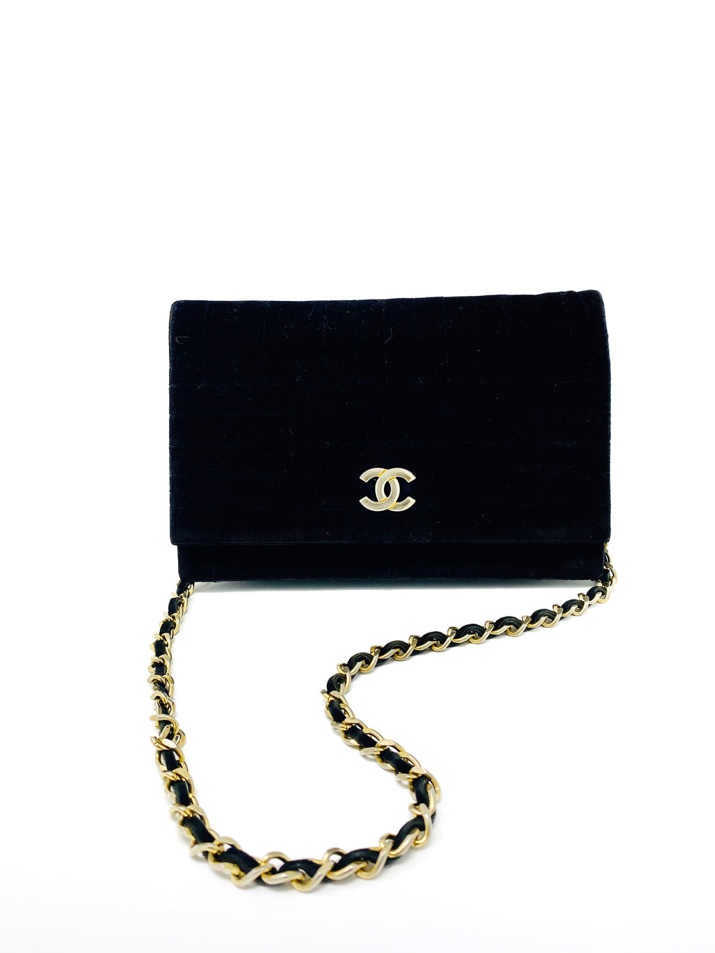 chanel black velvet bag with CC logo and chain.