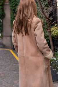 dior shearling coat, beige sheepskin, full length with buttons.