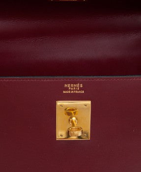 hermes kelly bag, burgundy leather, with lock and key.
