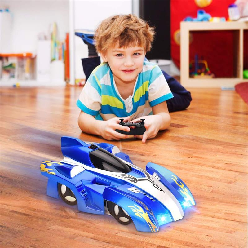 A Boy play with Hand Controlled RC Car Wall Climbing Remote Control Car