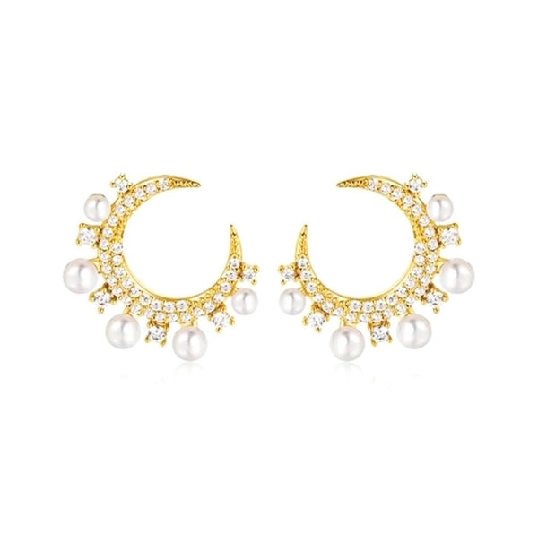 open hoop golden earrings with crystals and pearls on white background
