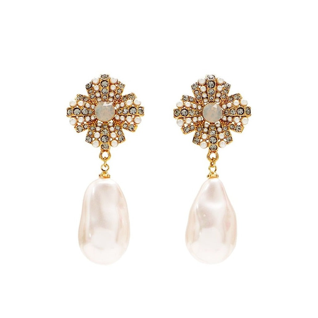 baroque crystal pearl drops suspended from crystal motif displayed on white background