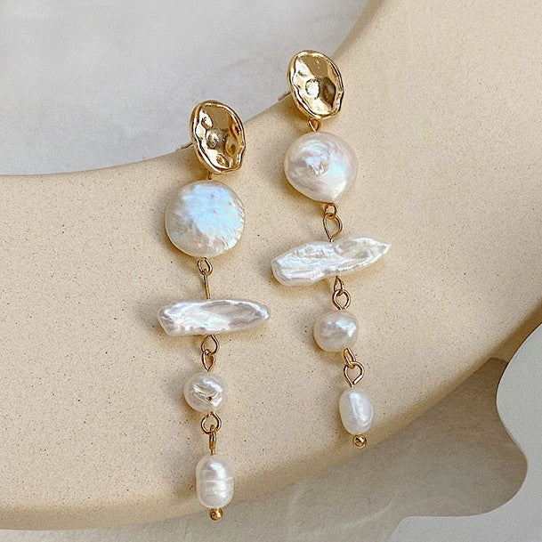pearl drop earrings feature a series of pearls in various shapes displayed on beige background