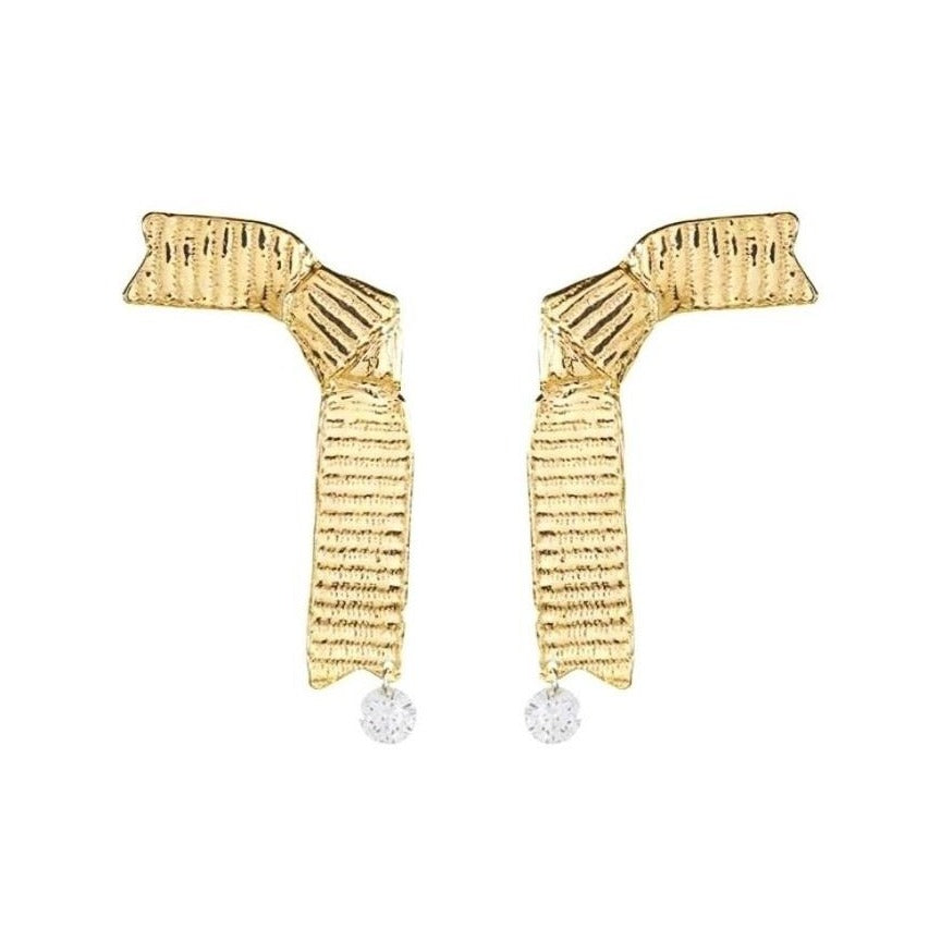 golden ribbon-shaped earrings with detailed texture and a crystal drop displayed on white background