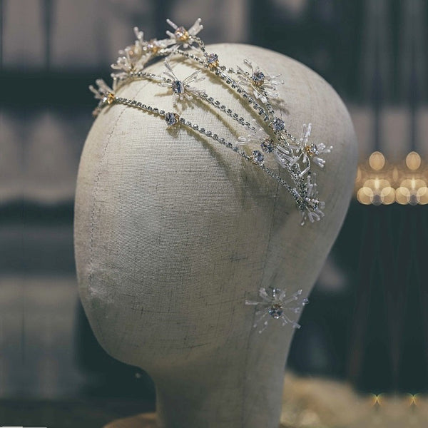 silver hairpiece and earring set on mannequin
