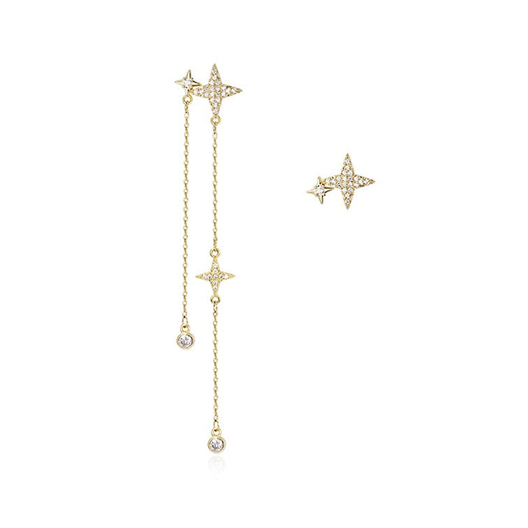 mismatch golden crystal star earrings displayed on white background