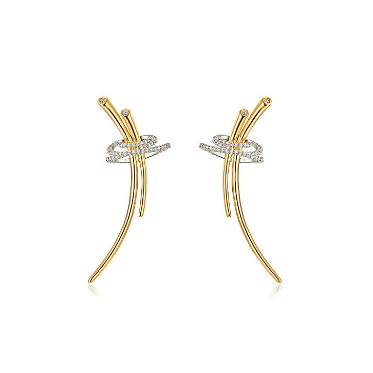 double golden-bar earrings accentuated with swirling strings of crystals displayed on white background