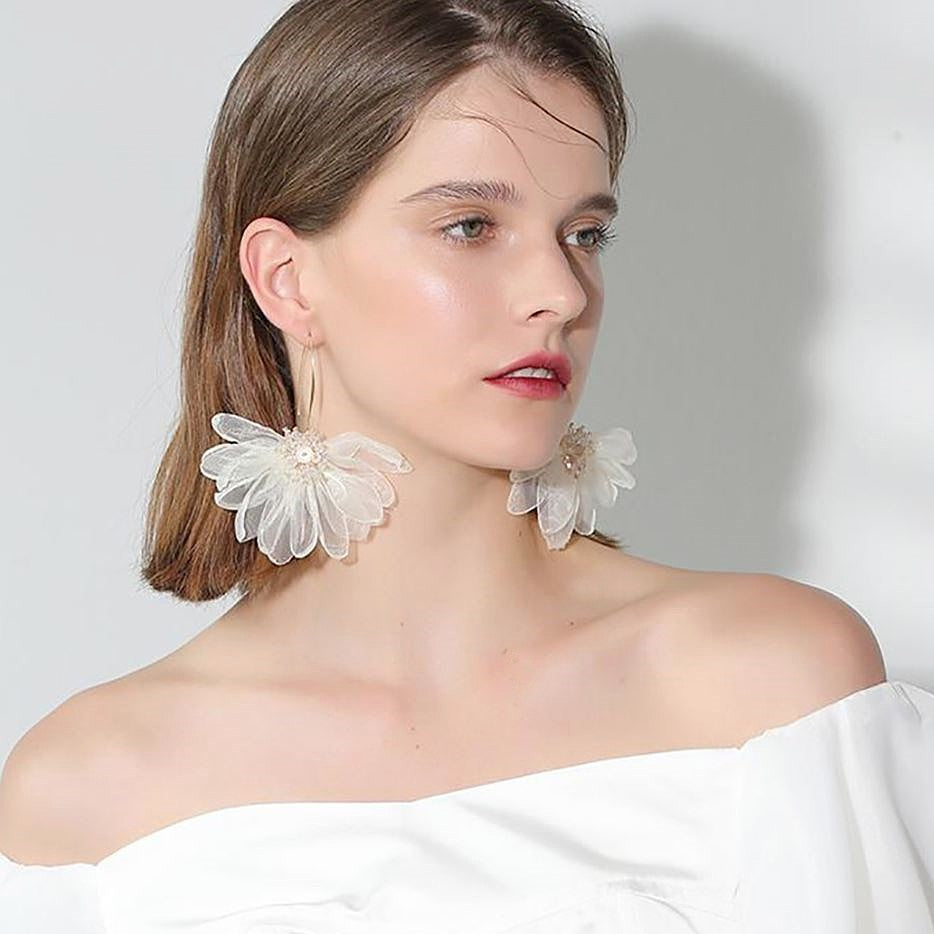 white flower drop earrings on model
