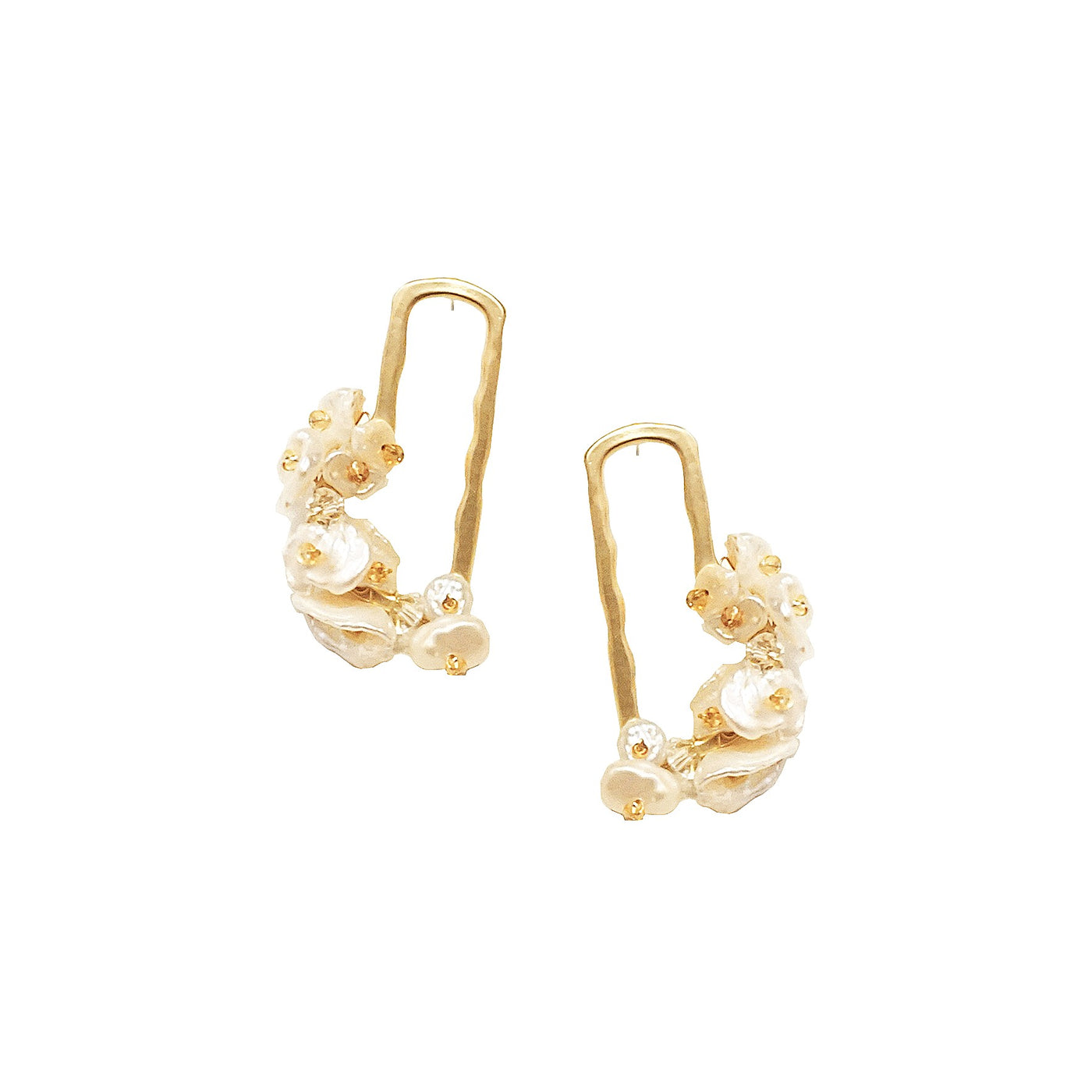 gold rectangular drop earrings with baroque pearl flowers displayed on white background