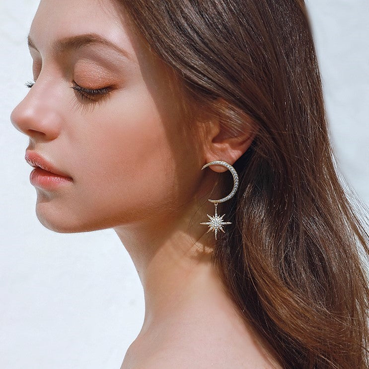 Golden and silver crescent and star shape earring on model
