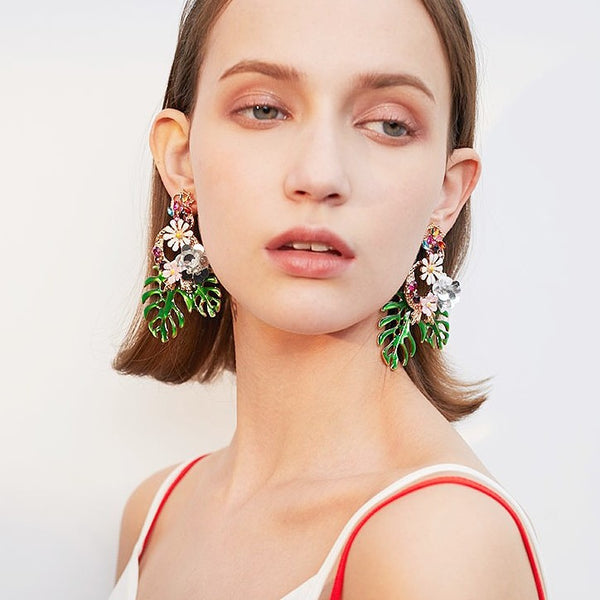 colorful flower and leaf drop earrings on model