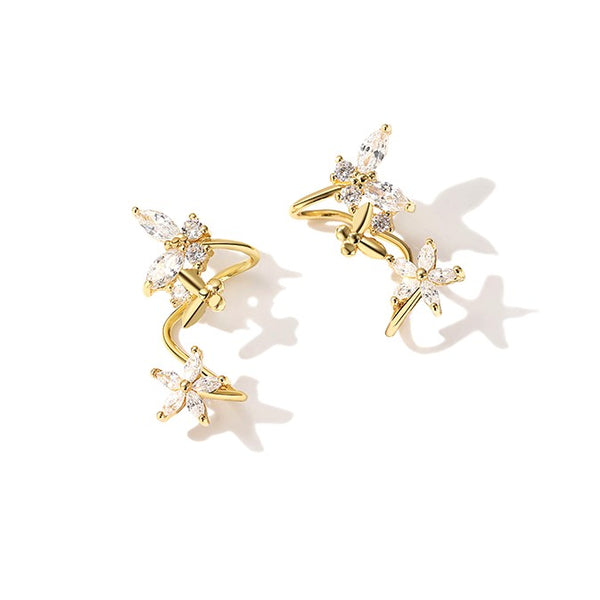 golden zircon earrings in twisted shape with star and butterfly decor