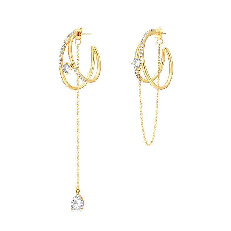 asymmetric double hoop earrings displayed on white background
