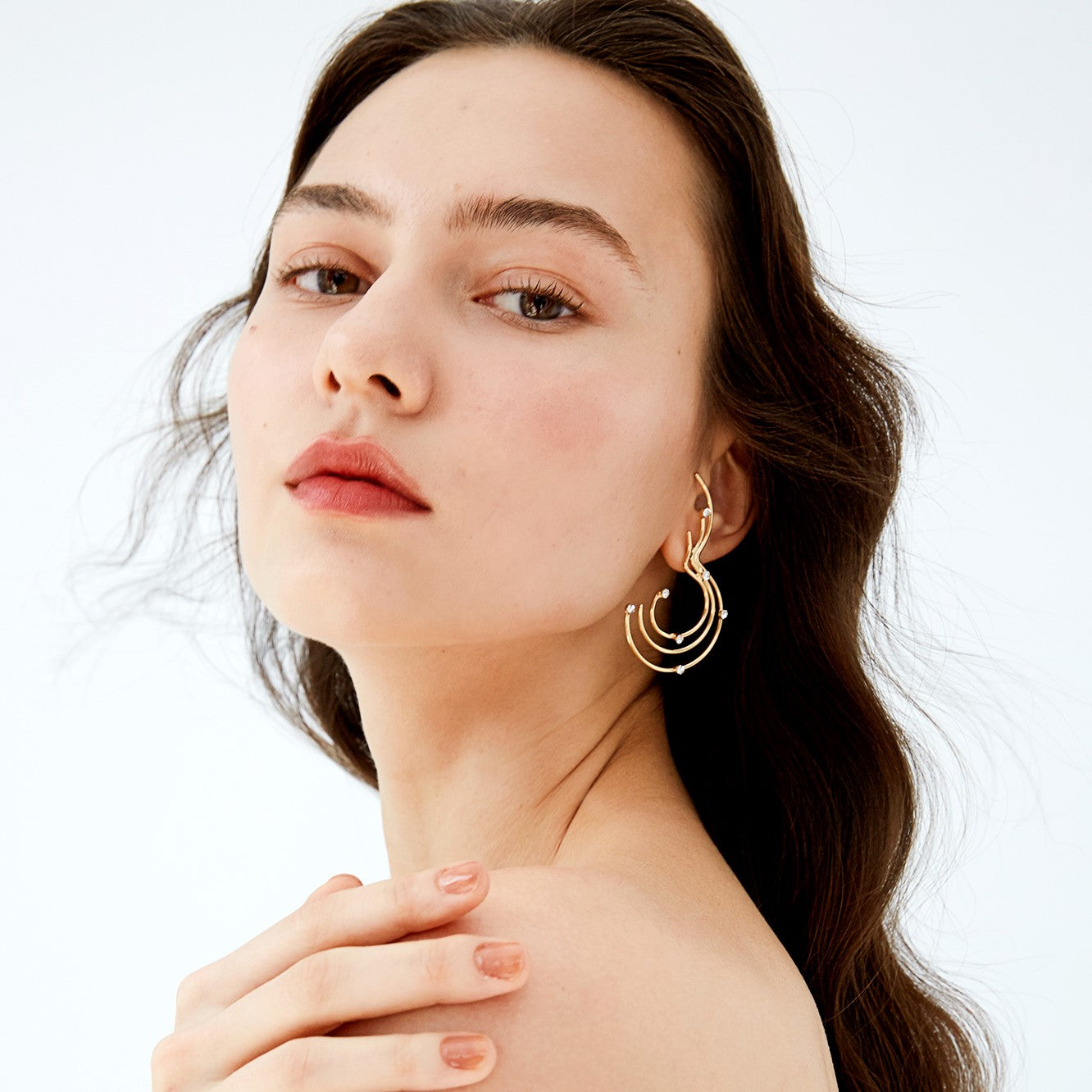 gold music notes inspired curved-bar earring accented with shimmering crystals on model