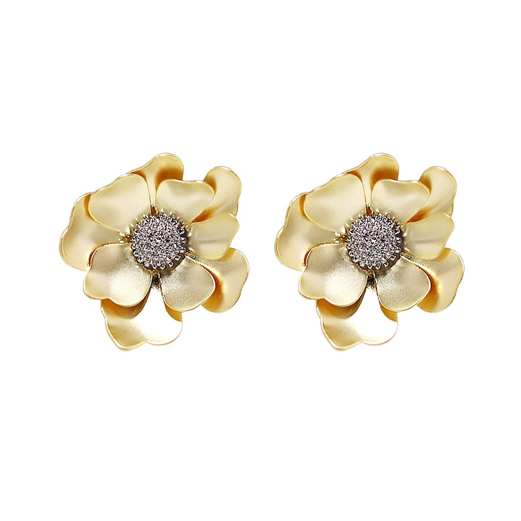 golden flower studs with silver stigma displayed on white background
