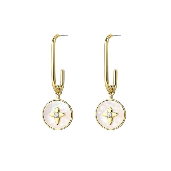 mother-of-pearl disk drops suspend from golden hoops displayed on white background