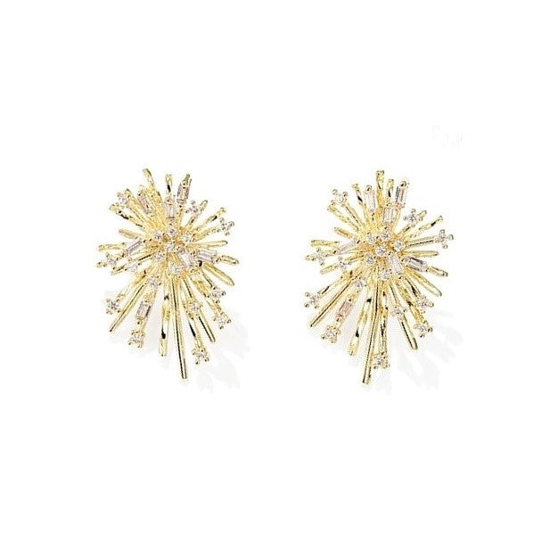 golden stardust shaped earrings with crystal decor displayed on white background