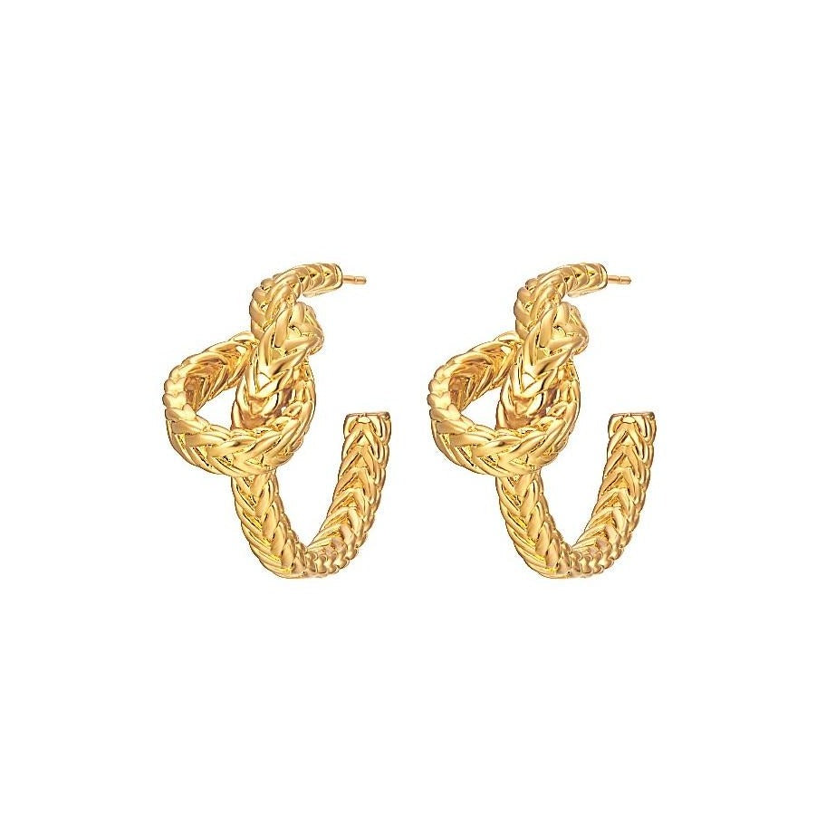 gold knotted hoop earrings displayed on white background