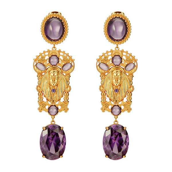 golden goddess drop earrings featuring purple crystals displayed on white background