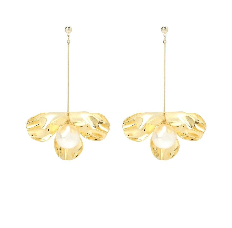 golden drop earrings in the shape of flower displayed on white background