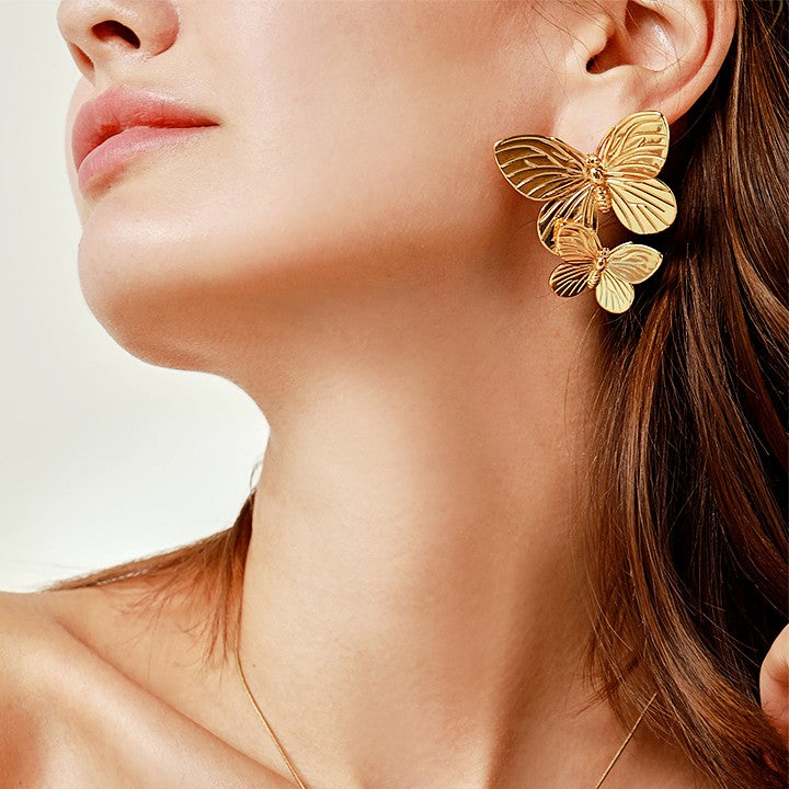 golden double butterfly earring on model