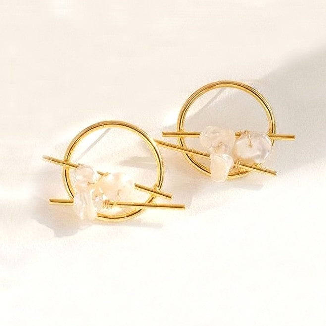 freshwater pearl studs in golden circle design displayed on white background