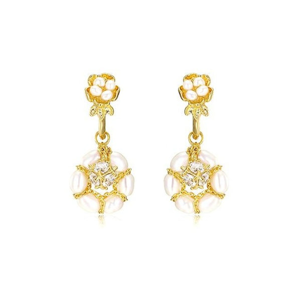 Golden flower drop earrings featuring pearl globes and shimmering crystals displayed on white background
